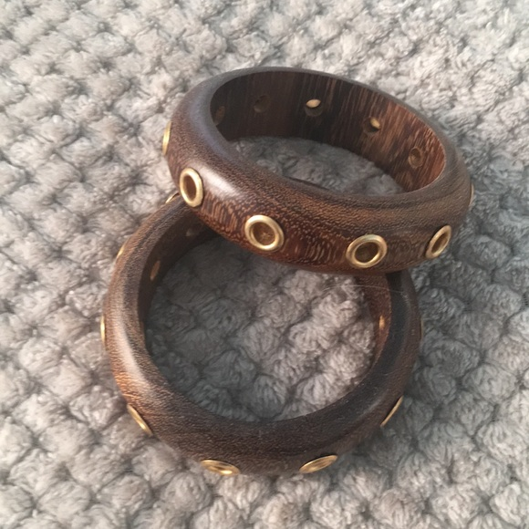 Jewelry - Two wood bangle bracelets with gold rivet detail.